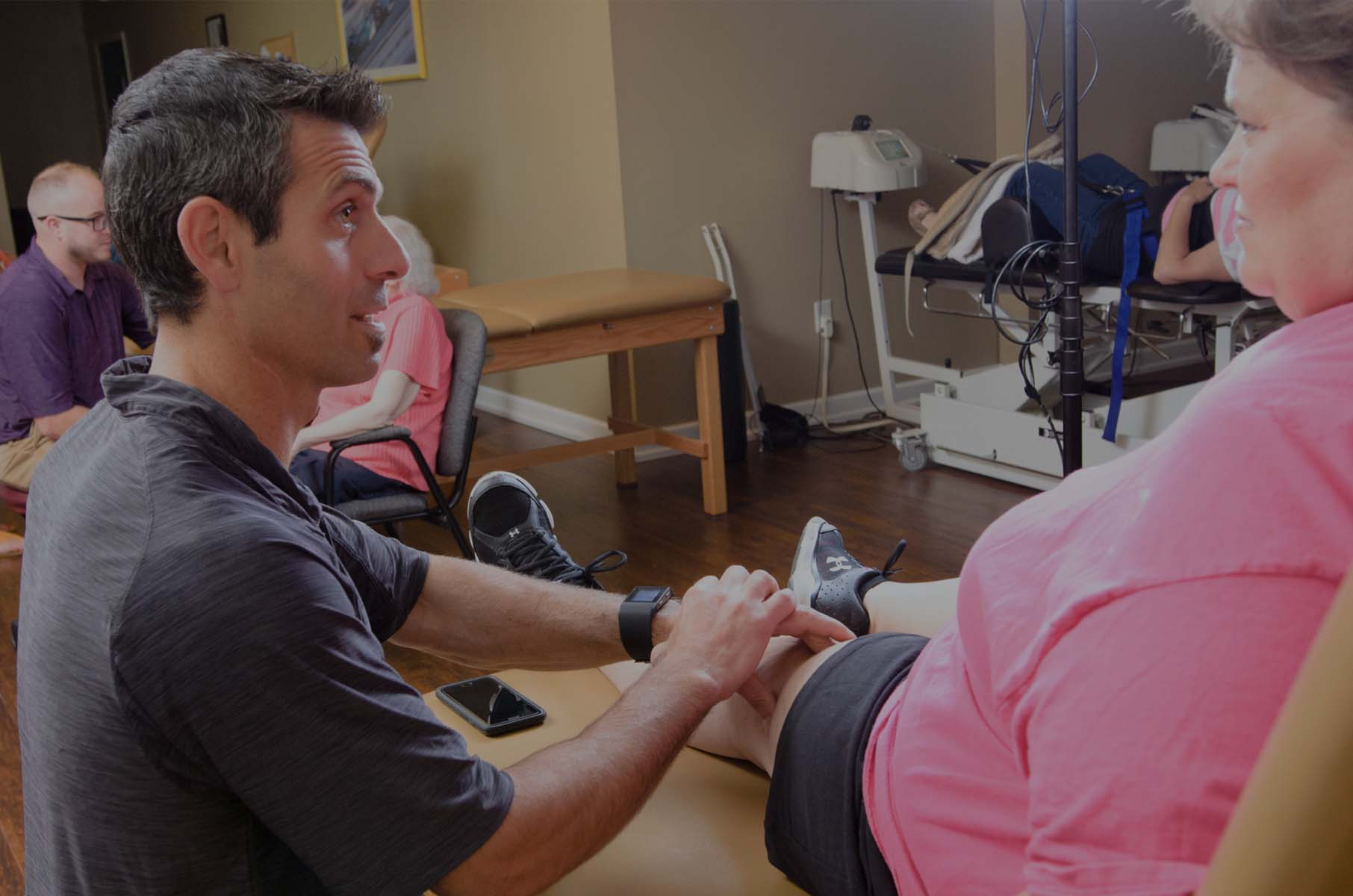 Pullano working with patient